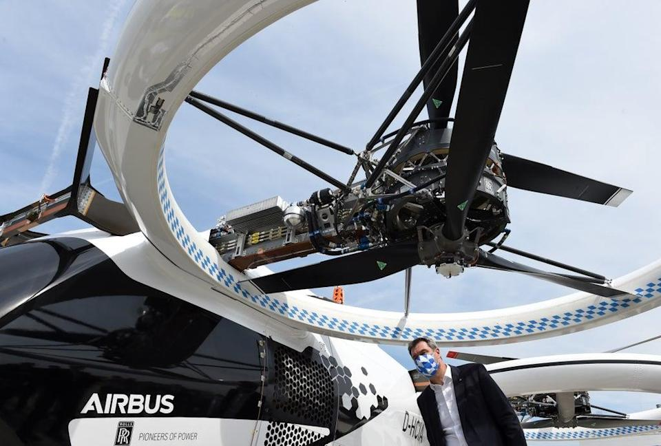 Bavaria's State Premier Markus Soeder looks at an electric helicopter during his visit to the Airbus helicopters production site in Donauwoerth, southern Germany, on July 20, 2020. (AFP via Getty Images)
