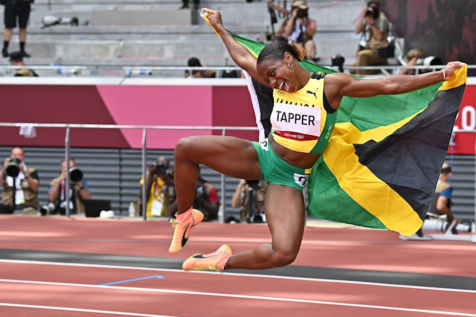 <p>Bronze medallist Jamaica's Megan Tapper celebrates after the women's 100m hurdles final during the Tokyo 2020 Olympic Games at the Olympic Stadium in Tokyo on August 2, 2021. (Photo by Ben STANSALL / AFP)</p>