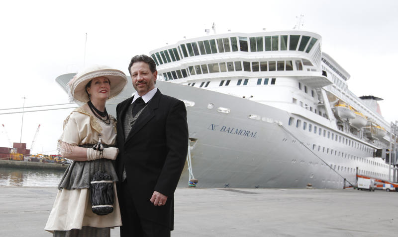 Mary Beth Crocker Dearing and her husband Tom Dearing from Newport Ky. pose for the media in period costume as they wait to board the MS Balmoral cruise ship in Southampton, England, Sunday, April 8, 2012. Nearly 100 years after the Titanic went down, a cruise with the same number of passengers aboard is setting sail to retrace the ship's voyage, including a visit to the location where it sank. The Titanic Memorial Cruise is set to depart Sunday from Southampton, where the Titanic left on its maiden voyage. The 12-night cruise will commemorate the 100th anniversary of the sinking of the White Star liner. With 1,309 passengers aboard, the MS Balmoral will follow the same route as the Titanic. Organizers are trying to recreate the onboard experience minus the disaster from the food to a band playing music from that era.Organizers said people from 28 countries have booked passage, including relatives of some of the more than 1,500 people who died when the Titanic collided with an iceberg and sank on April 15, 1912.(AP Photo/Alastair Grant)