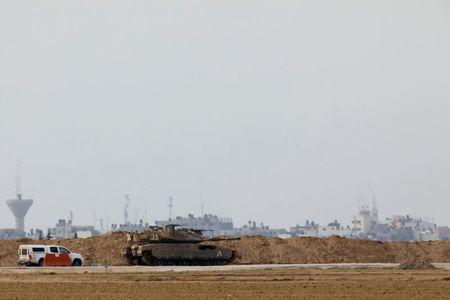 """An Israeli tank is seen near what the Israeli forces said was a """"significant"""" cross-border attack tunnel from the Gaza Strip, which was being dug by the enclave's dominant Islamist group, Hamas, near Israel's border with the Gaza Strip December 10, 2017. REUTERS/Amir Cohen"""