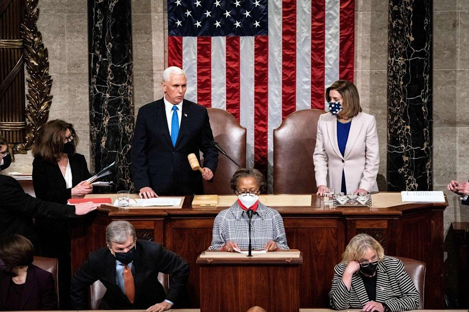 Vice President Mike Pence and House Speaker Nancy Pelosi preside over a Joint session of Congress