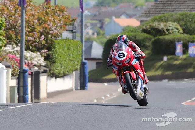 "Track action, Isle of Man TT <span class=""copyright"">Honda</span>"
