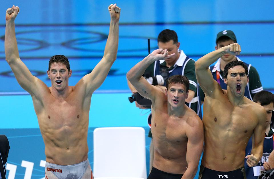 LONDON, ENGLAND - JULY 31: Conor Dwyer, Ryan Lochte and Ricky Berens applaud teammate Michael Phelps as he wins the gold in the Men's 4 x 200m Freestyle Relay final on Day 4 of the London 2012 Olympic Games at the Aquatics Centre on July 31, 2012 in London, England. (Photo by Streeter Lecka/Getty Images)