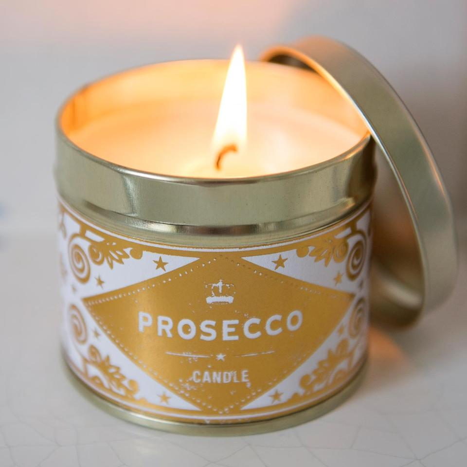 """<p>Light and fruity, you can get your spritz of bubbles without drinking any alcohol. The sparkling scent will burn for 40 hours, so that's at definitely a few boxsets worth. <a rel=""""nofollow"""" href=""""https://www.thepresentfinder.co.uk/buy/prosecco-scented-candle_2375.htm"""">Buy Here</a> </p>"""