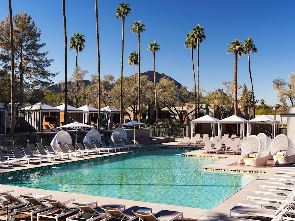 """<p>Enjoy midcentury vibes, views of Camelback Mountain, and all the desert sunshine you can handle at <a href=""""https://www.cntraveler.com/hotels/scottsdale/andaz-scottsdale-resort-and-spa?mbid=synd_yahoo_rss"""" rel=""""nofollow noopener"""" target=""""_blank"""" data-ylk=""""slk:Andaz Scottsdale Resort & Bungalows"""" class=""""link rapid-noclick-resp"""">Andaz Scottsdale Resort & Bungalows</a> (<em>rooms from $489)</em>, which offers day passes on ResortPass. The entry-level tier starts at just $40 and includes pool and hot tub access, poolside food and drink service, shower facilities, and complimentary valet parking. Upgrade to a cabana booking for $250, and you get day passes for up to four adults, as well as a cooler filled with chilled still and sparkling water, a complimentary chef's choice cabana snack, and your very own selfie stick to document the fun.</p> <p><strong>Reserve a spot</strong>: <a href=""""https://www.resortpass.com/hotels/andaz-scottsdale-resort-and-spa"""" rel=""""nofollow noopener"""" target=""""_blank"""" data-ylk=""""slk:resortpass.com"""" class=""""link rapid-noclick-resp"""">resortpass.com</a></p>"""