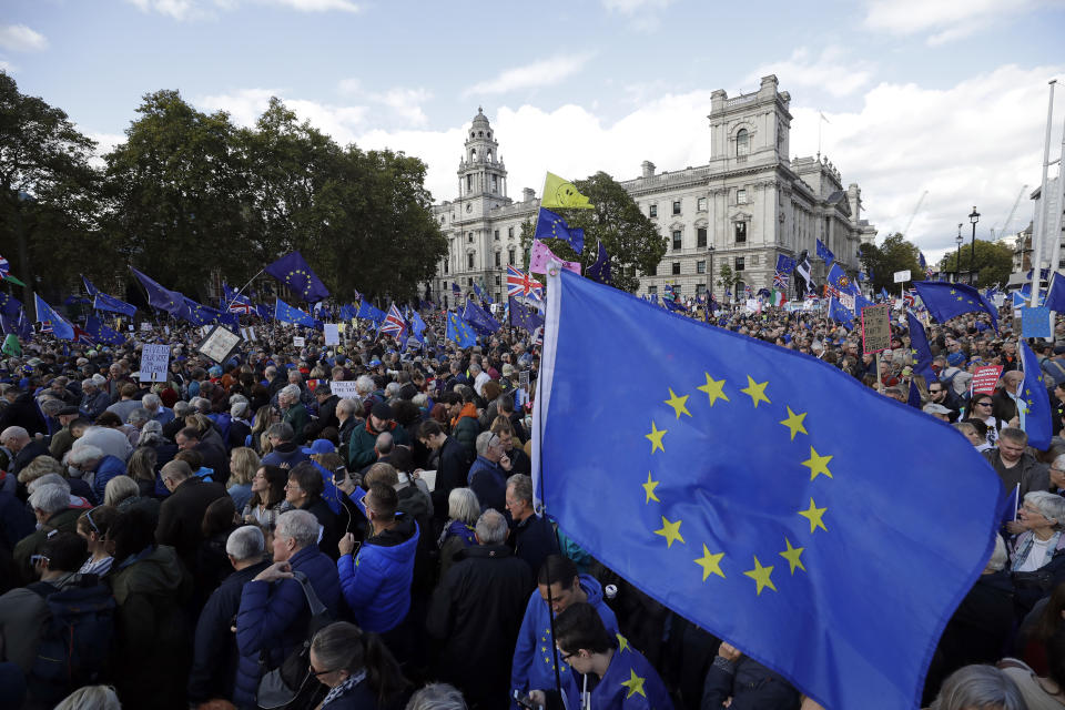 """Anti-Brexit remain in the European Union supporters gather after taking part in a """"People's Vote"""" protest march calling for another referendum on Britain's EU membership, in Parliament Square in London, Saturday, Oct. 19, 2019. Britain's Parliament is set to vote in a rare Saturday sitting on Prime Minister Boris Johnson's new deal with the European Union, a decisive moment in the prolonged bid to end the Brexit stalemate. Various scenarios may be put in motion by the vote. (AP Photo/Matt Dunham)"""