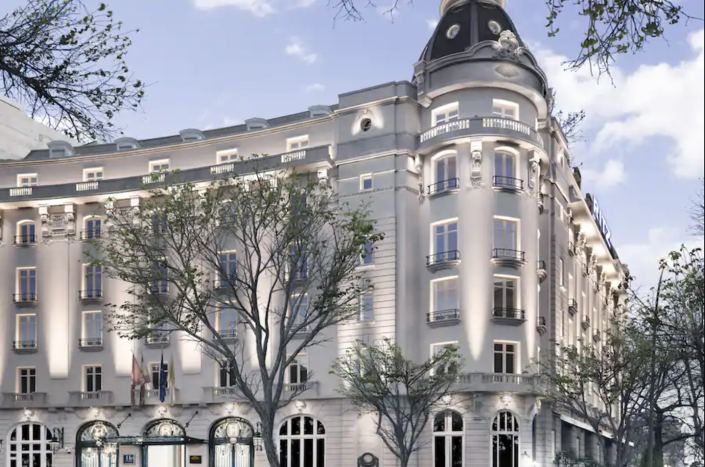 """<p>The iconic 110-year-old building has undergone extensive renovations to return to its former glory as one of Europe's most prestigious hotels. After a delayed opening due to COVID-19, <a href=""""https://www.mandarinoriental.com/madrid/hotel-ritz/luxury-hotel/presentation"""" rel=""""nofollow noopener"""" target=""""_blank"""" data-ylk=""""slk:Mandarin Oriental Ritz, Madrid"""" class=""""link rapid-noclick-resp"""">Mandarin Oriental Ritz, Madrid</a> is set to open its doors in 2021, and we can hardly way to discover every inch of this Belle Epoque–style hotel. Art aficionados will adore this property, as it's located in Madrid's Triangle of Art, with the most revered museums, financial and commercial district, and El Retiro Park just around the corner. The Royal and Presidential suites will even feature views of the legendary Prado Museum.</p><p><em>Mandarin Oriental Ritz, Madrid reopened in April 2021. Nightly rates start at $603.</em></p>"""