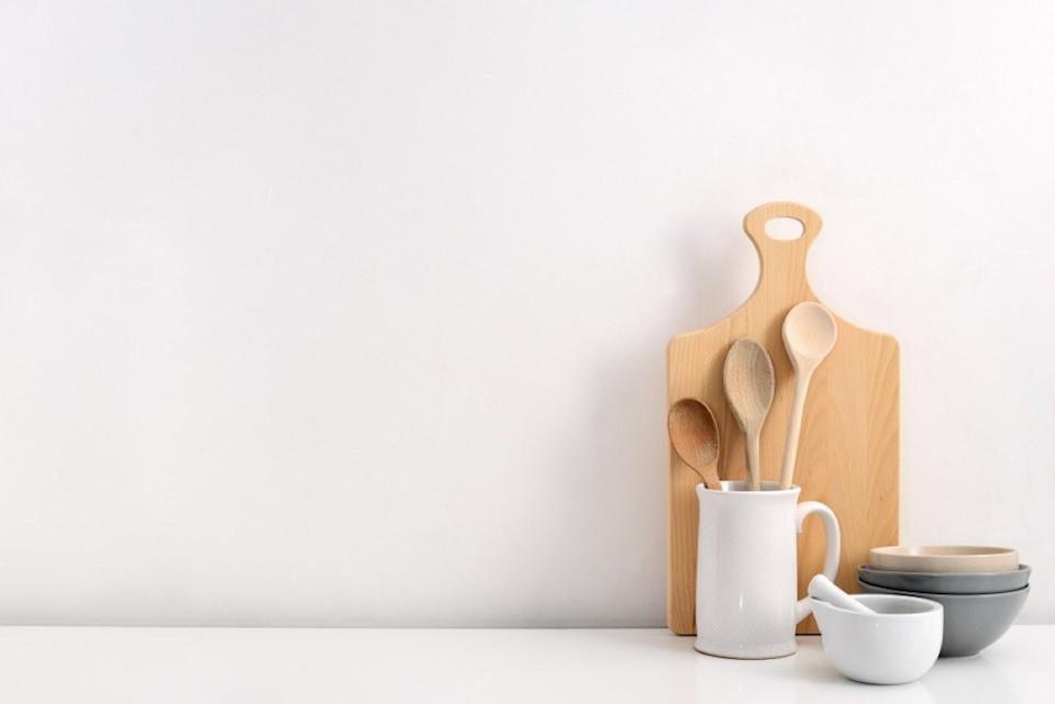wooden spoons and cutting board against white wall, interior design mistakes