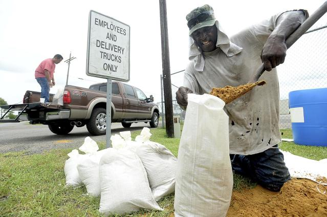 <p>Mike Phillips of Beaumont fills bags with sand at the Jefferson County Precinct 4 Service Center Tuesday, as he and others prepare for potential flooding due to the approaching tropical storm, June 20, 2017. (Photo: Kim Brent/Beaumont Enterprise via AP) </p>