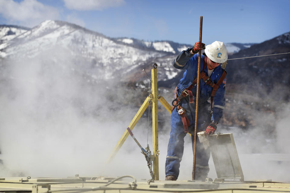 <p> In this March 29, 2013 photo, a worker checks a dipstick to check water levels and temperatures in a series of tanks at an Encana Oil & Gas (USA) Inc. hydraulic fracturing operation at a gas drilling site outside Rifle, Colorado. In the 2000s, large investors in so-called clean technology wanted to finance companies that would help eliminate the world's dependence on oil, natural gas and coal. But in 2013, clean technology investment funds are not trying to replace the fossil fuel industry, they're trying to help it by financing companies that can make mining and drilling less dirty. (AP Photo/Brennan Linsley)</p>