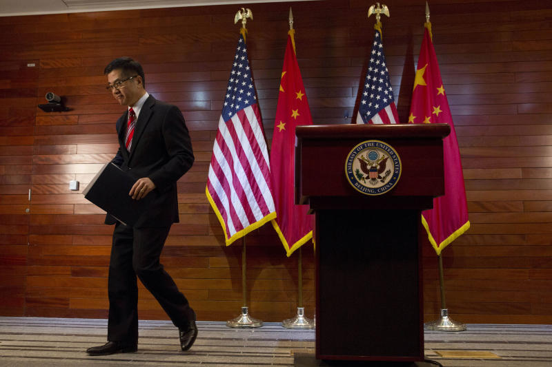 FILE - In this Thursday, Feb. 27, 2014, file photo, Gary Locke, the outgoing U.S. ambassador to China, leaves after a farewell news conference held at the U.S. Embassy in Beijing. A major Chinese government news service used a racist slur to describe Locke in a mean-spirited editorial on Friday that drew widespread public condemnation in China. (AP Photo/Ng Han Guan, Pool, File)