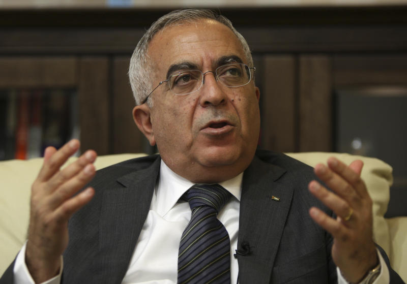 FILE - In this  Tuesday, June 28, 2011 file photo, Palestinian Prime Minister Salam Fayyad speaks during an interview with The Associated Press in the West Bank city of Ramallah. A spokesman says Fayyad has been hospitalized with an abdominal infection on Monday, April 1, 2013. (AP Photo/Majdi Mohammed, File)