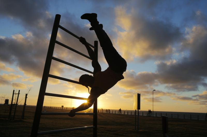 Cape Town residents train at an outdoor fitness park in the city's Sea Point suburb