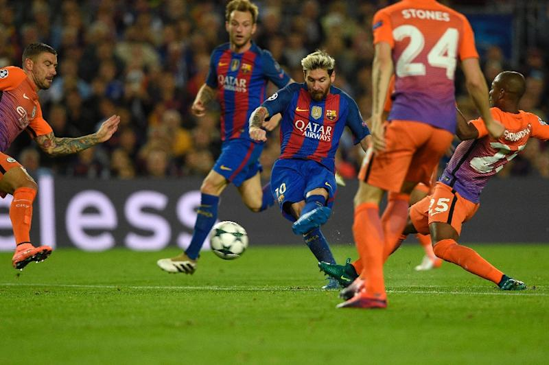 Barcelona's forward Lionel Messi (C) shoots to score a goal during the UEFA Champions League football match FC Barcelona vs Manchester City at the Camp Nou stadium in Barcelona on October 19, 2016 (AFP Photo/Lluis Gene)