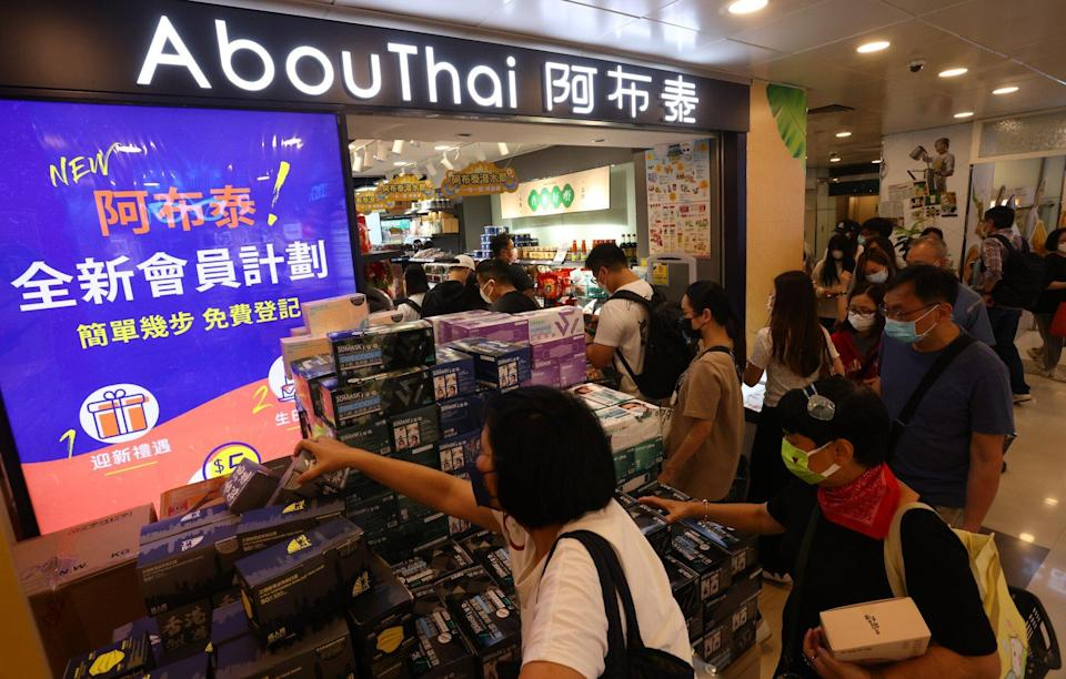 Long queue of shoppers outside AbouThai store in Mong Kwok. Photo: Nora Tam