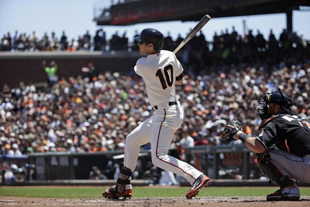 San Francisco Giants' Tyler Colvin drives in a run with a single against the Miami Marlins during the first inning of a baseball game on Sunday, May 18, 2014, in San Francisco. (AP Photo/Marcio Jose Sanchez)