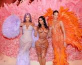 """<p>In 2019, we saw the whole family go ultra-glam with their custom designer ensembles. How could we forget <a href=""""https://www.popsugar.com/fashion/Kendall-Jenner-Dress-2019-Met-Gala-46118273"""" class=""""link rapid-noclick-resp"""" rel=""""nofollow noopener"""" target=""""_blank"""" data-ylk=""""slk:Kendall and Kylie's feathered looks"""">Kendall and Kylie's feathered looks</a> or <a href=""""https://www.popsugar.com/fashion/Kim-Kardashian-Dress-2019-Met-Gala-46118544"""" class=""""link rapid-noclick-resp"""" rel=""""nofollow noopener"""" target=""""_blank"""" data-ylk=""""slk:Kim's dripping Mugler outfit"""">Kim's dripping Mugler outfit</a>?</p>"""