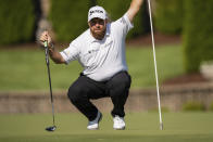 Shane Lowry lines up his putt on the seventh hole during the third round of the Wells Fargo Championship golf tournament at Quail Hollow, Saturday, May 8, 2021, in Charlotte, N.C. (AP Photo/Jacob Kupferman)