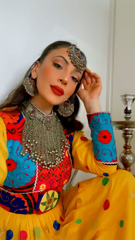 A woman poses in traditional Afghan attire, in Stavanger