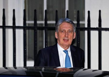 Britain's Chancellor of the Exchequer Philip Hammond leaves number 11 Downing St in London
