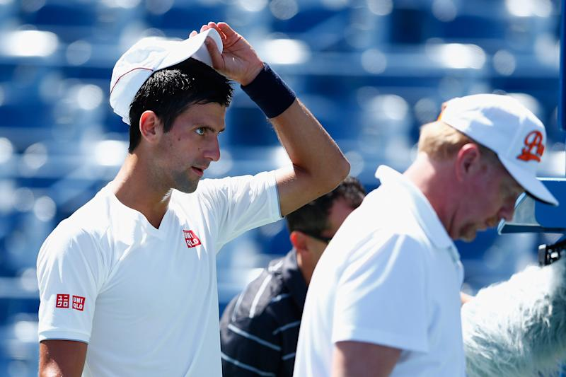 NEW YORK, NY - AUGUST 24: Novak Djokovic practices for the US Open with his coach, Boris Becker. Julian Finney/Getty Images/AFP (AFP Photo/JULIAN FINNEY)