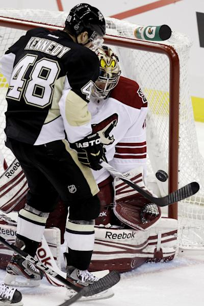 Pittsburgh Penguins' Tyler Kennedy (48) can't get his stick on a rebound off Phoenix Coyotes goalie Mike Smith in the first period of an NHL hockey game in Pittsburgh, Monday, March 5, 2012. (AP Photo/Gene J. Puskar)
