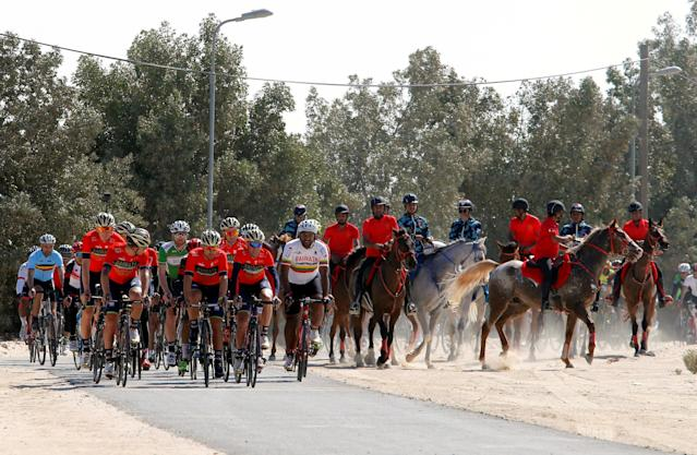 REFILE - CORRECTING COUNTRY SPELLING Hundreds of cyclists ride with the Bahrain-Merida Pro Cycling Team, seen at the front, during their social cycle ride to promote the sports in the country, in Manama, Bahrain February 2, 2018. REUTERS/Hamad I Mohammed