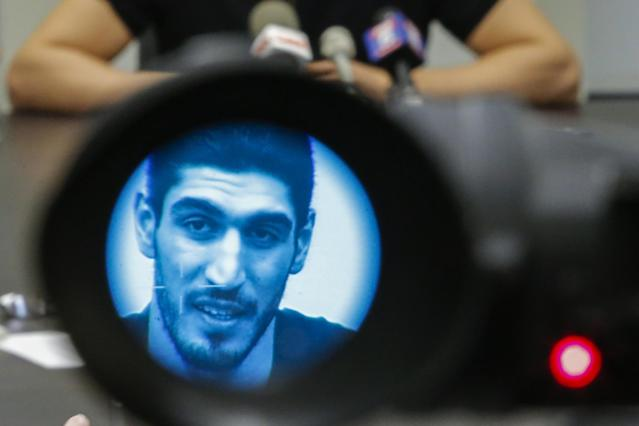 "<a class=""link rapid-noclick-resp"" href=""/nba/players/4899/"" data-ylk=""slk:Enes Kanter"">Enes Kanter</a>, seen through a video camera, speaks to the media during a news conference about his detention at a Romanian airport on May 22, 2017 in New York City. (Eduardo Munoz Alvarez/Getty Images)"