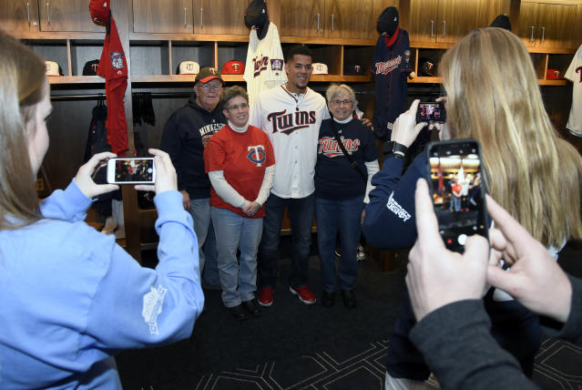 Minnesota Twins' Jose Berrios poses for a photo with fans during day two at the baseball team's TwinsFest Saturday, Jan. 20, 2018 in Minneapolis. (AP Photo/Hannah Foslien)