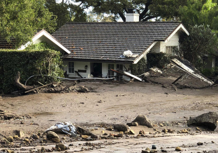 <p>A home is buried in flood debris in Montecito, Calif., Tuesday, Jan. 9, 2018. (Photo: Mike Eliason/Santa Barbara County Fire Department via AP) </p>