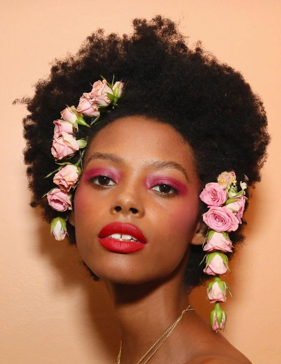 <p>Keep the romantic theme going with bold magenta eyes and scarlet lips. Just don't forget the fresh flowers in your hair.</p>