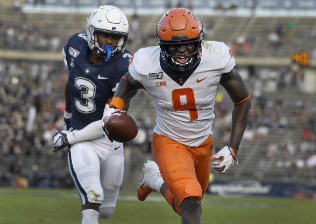 Illinois wide receiver Josh Imatorbhebhe (9) runs into the end zone for a touchdown against Connecticut defensive back Diamond Harrell (3) during the second half of an NCAA college football game, Saturday, Sept. 7, 2019, in East Hartford, Conn. (AP Photo/Jessica Hill)