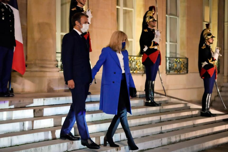 France's President Emmanuel Macron, left, and his wife Brigitte Macron, welcome the Greek Prime Minister Kyriakos Mitsotakis and his wife Mareva Grabowski, prior to a dinner at the Elysee Palace, in Paris, Sept. 27. - Credit: AP
