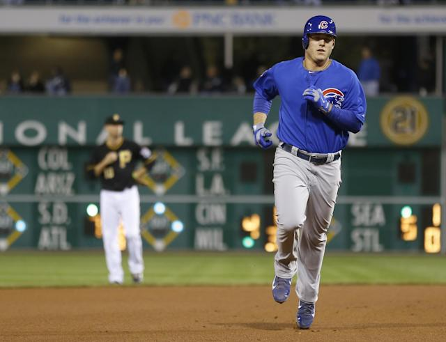 Chicago Cubs' Anthony Rizzo, right, rounds the bases past Pittsburgh Pirates shortstop Jordy Mercer after hitting a two-run home run in the seventh inning of the baseball game on Friday, Sept. 13, 2013, in Pittsburgh. The Cubs won 5-4. (AP Photo/Keith Srakocic)