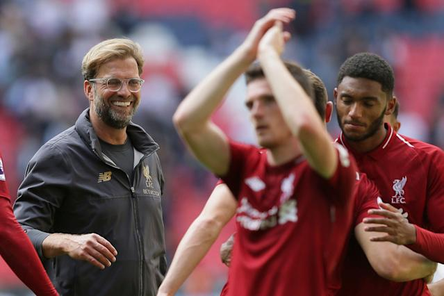 It's a good bet Jurgen Klopp, left, and Liverpool will be smiling after their match vs. Tottenham on Sunday. (Associated Press)
