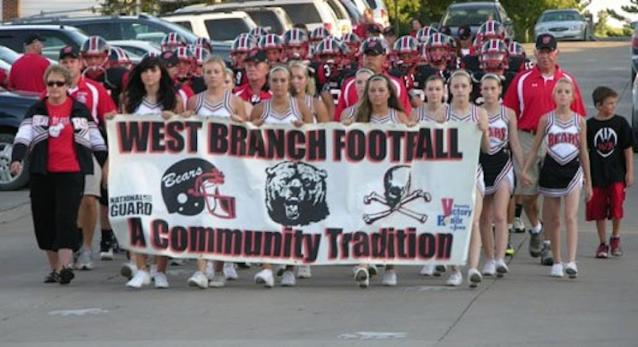 The West Branch football program marches from the school to the Little Rose Bowl — Facebook