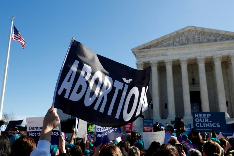 FILE PHOTO: FILE PHOTO: U.S. Supreme Court justices hear a major abortion case on the legality of a Republican-backed Louisiana law that imposes restrictions on abortion doctors, on Capitol Hill in Washington
