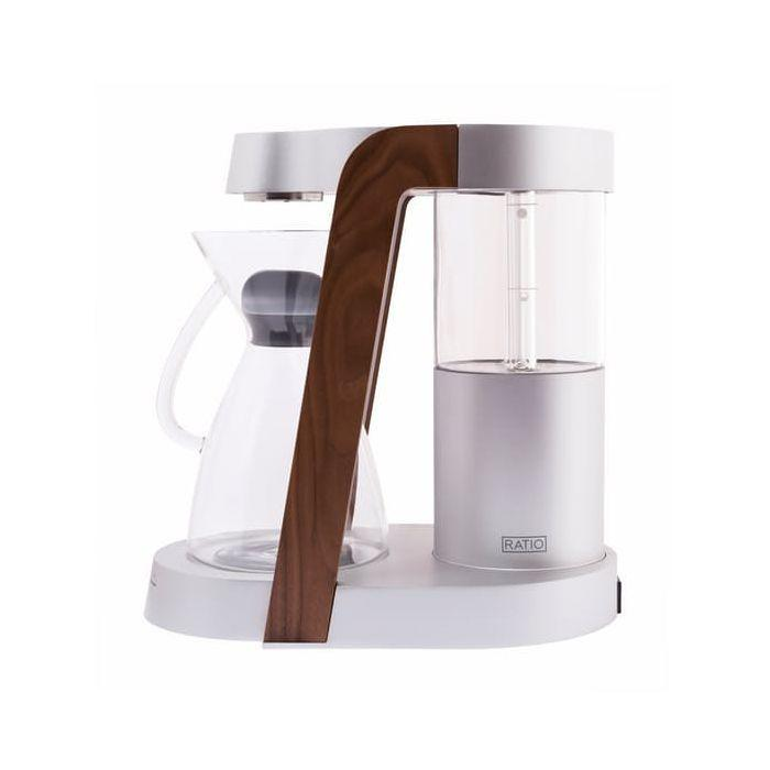 "<p>The Ratio Eight is probably the nicest looking coffee machine on the market – and even though it produces a good cup of home brew, you're really paying a premium for the minimalist mid-century-inflected aesthetic; the walnut trim, the aluminium stand (available in white, silver, cobalt, oyster or black), the handblown glass water tank and cork carafe bottom. It's also simple, with just one button that cycles through three stages of coffee production: 'Bloom' (which hits the coffee grounds with a burst of hot water, helping to rid them of CO2), 'Brew' and 'Ready'. We wouldn't exactly describe it as quick – a full brew takes between three to six minutes – but the end result is impressively clear and smooth, perfectly recreating the results of the pour over method. Be warned, though: it's much bigger than it appears online, so carve some space out in your kitchen. It deserves pride of place, after all.</p><p><a class=""body-btn-link"" href=""https://go.redirectingat.com?id=127X1599956&url=https%3A%2F%2Fwww.coffee-box.co.uk%2Fratio-eight-coffee-maker-white-walnut.html%3FrefSrc%3D3409%26nosto%3Dnosto-page-product1&sref=https%3A%2F%2Fwww.esquire.com%2Fuk%2Ffood-drink%2Fg32206992%2Fbest-coffee-machines%2F"" target=""_blank"">BUY</a></p><p>£625, coffee-box.co.uk</p>"
