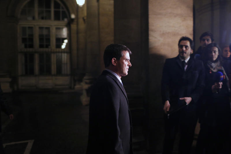 France's Interior Minister Manuel Valls arrives to give a press conference, at the Quai des Orfevres police building, in Paris, Thursday, Nov. 21, 2013. After a two-day nationwide manhunt, French police arrested a man Wednesday night suspected of shooting a newspaper assistant photographer and three other attacks. (AP Photo/Thibault Camus)