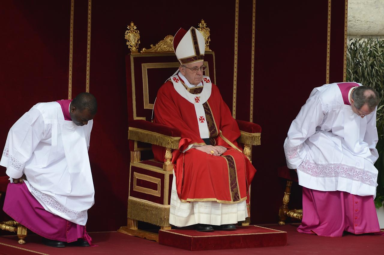 VATICAN CITY, VATICAN - MARCH 24:  Pope Francis conducts Palm Sunday Mass in St Peter's Square on March 24, 2013 in Vatican City, Vatican. Pope Francis lead his first mass of Holy Week as pontiff by celebrating Palm Sunday in front of thousands of faithful and clergy. The pope's first holy week will also incorporate him washing the feet of prisoners in a youth detention centre in Rome next Thursday, 28th March.  (Photo by Jeff J Mitchell/Getty Images)
