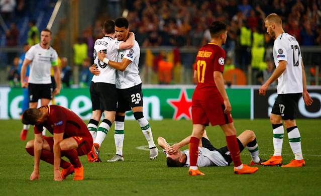 Soccer Football - Champions League Semi Final Second Leg - AS Roma v Liverpool - Stadio Olimpico, Rome, Italy - May 2, 2018 Liverpool's Dominic Solanke and Andrew Robertson celebrate as Roma players look dejected after the match REUTERS/Tony Gentile