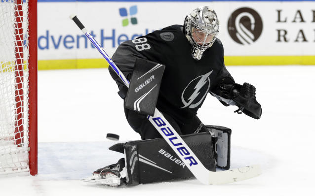 Tampa Bay Lightning goaltender Andrei Vasilevskiy (88) makes a save on a shot by the Pittsburgh Penguins during the first period of an NHL hockey game Saturday, Feb. 9, 2019, in Tampa, Fla. (AP Photo/Chris O'Meara)