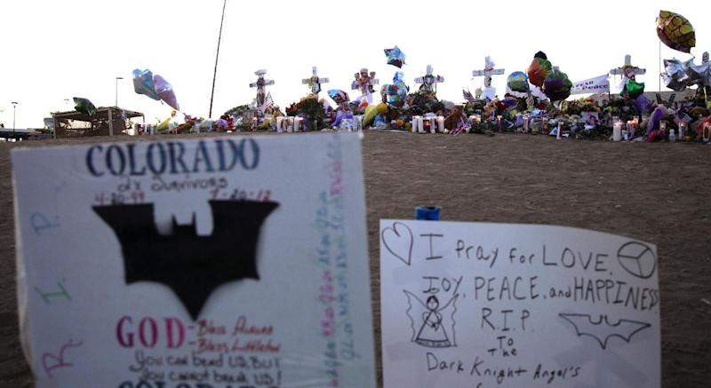 "Messages of hope and the Batman logo are shown on signs at the memorial to victims of the Aurora, Colo., movie theater shooting, Friday, July 27, 2012. It was a week ago Friday that a gunman opened fire during a late-night showing of ""The Dark Knight Rises"" Batman movie, killing 12 and injuring dozens of others. Police have identified the suspected shooter as James Holmes, 24. (AP Photo/Ted S. Warren)"