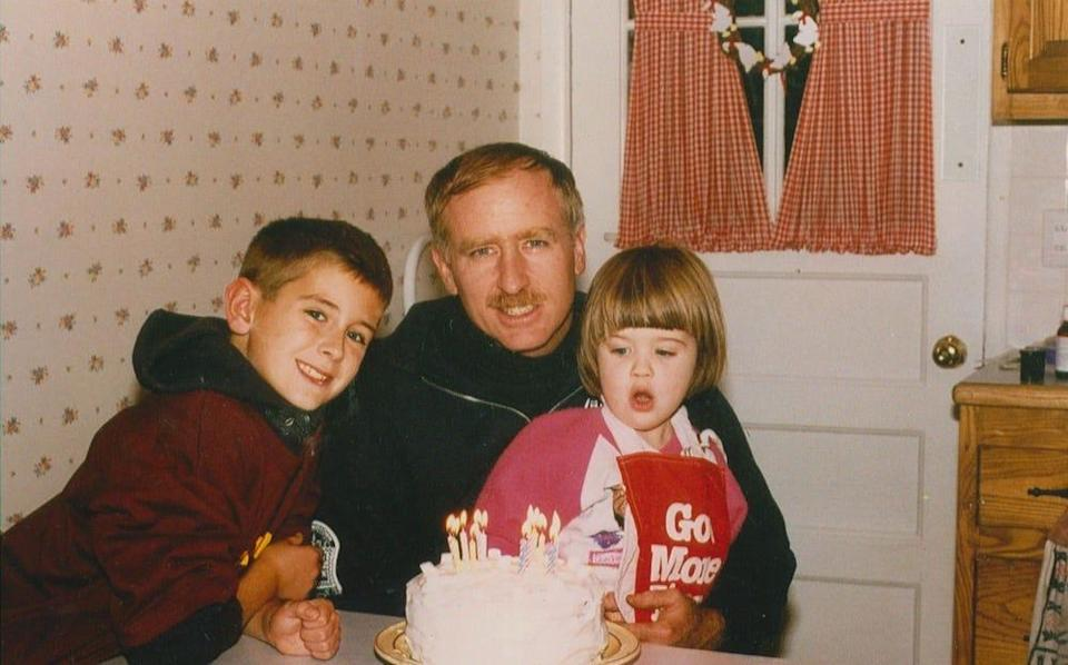 Brian with his father, Joseph, and his sister, Caitlin, celebrating his father's birthday in 1994 or 1995.