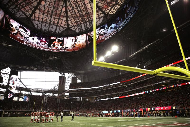 FILE - In this Dec. 31, 2017, file photo, the Atlanta Falcons and Carolina Panthers huddle during the first half of an NFL football game, in Atlanta. Atlanta's new $1.5 billion stadium is about to be on perhaps its largest national stage for the Monday, Jan. 8, 2018, College Football Playoff title game, fans say the glitzy facility is living up to the hype despite a series of construction setbacks that delayed its opening. (AP Photo/David Goldman, File)