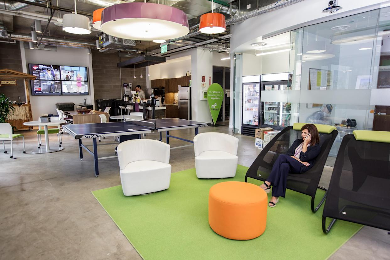The main area in the MapQuest offices has comfortable chairs, a ping-pong table, a kitchen and snack area. (Photo credit: Joanna B. Pinneo/The Washington Post/Getty Images)