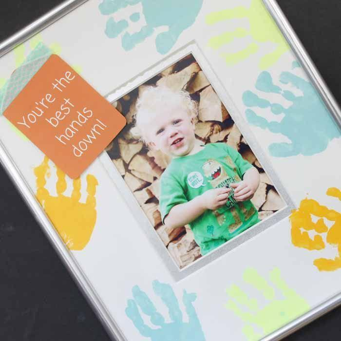 """<p>A dad can never have too many photos of his kids — especially if that photo comes in a handmade handprint frame. </p><p><strong><em>Get the tutorial at <a href=""""https://www.thecountrychiccottage.net/handprint-painting/"""" rel=""""nofollow noopener"""" target=""""_blank"""" data-ylk=""""slk:The Country Chic Cottage"""" class=""""link rapid-noclick-resp"""">The Country Chic Cottage</a>. </em></strong></p><p><a class=""""link rapid-noclick-resp"""" href=""""https://www.amazon.com/FolkArt-Multi-Surface-Paint-PROMO830-12-Pack/dp/B00I9WM69O?tag=syn-yahoo-20&ascsubtag=%5Bartid%7C10070.g.2461%5Bsrc%7Cyahoo-us"""" rel=""""nofollow noopener"""" target=""""_blank"""" data-ylk=""""slk:SHOP CRAFT PAINT"""">SHOP CRAFT PAINT</a></p>"""