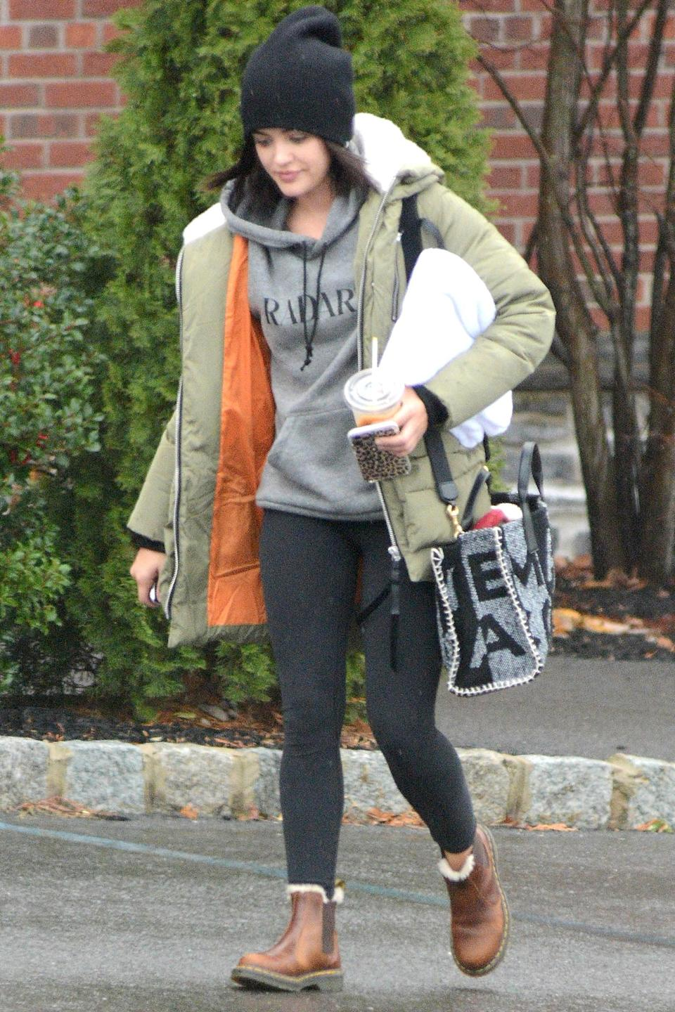<p>Lucy Hale has her hands full during an outing in N.Y.C.</p>