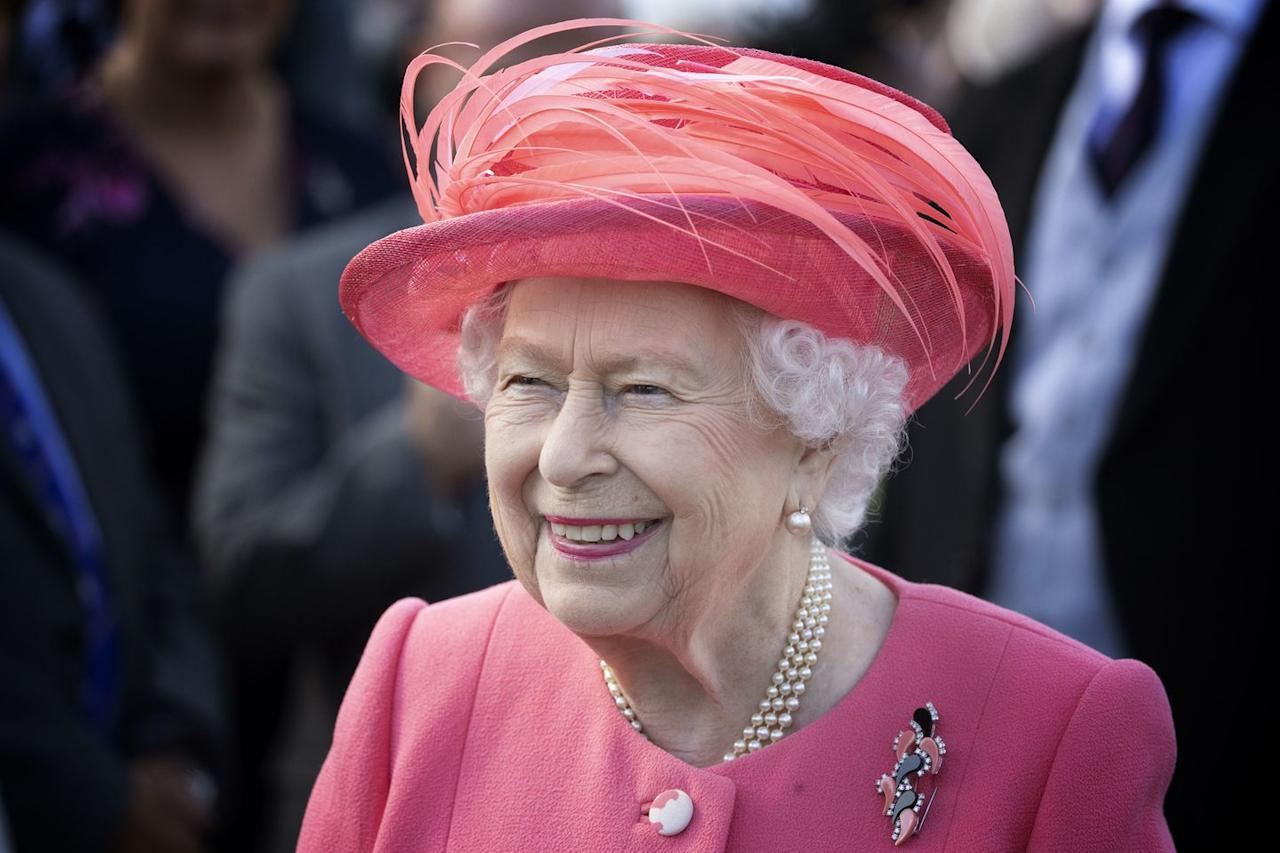<p>Queen Elizabeth wore a pink coat and hat for the occasion.</p>