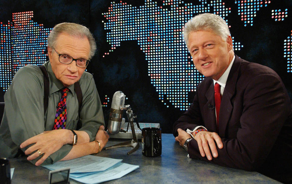 Former President Bill Clinton (R) speaks with Larry King on CNN in New  York on September 3, 2002, about the Families of Freedom Scholarship  Fund. Clinton and former Senator Bob Dole have raised over $100 million  to fund college scholarships for dependent children who lost a parent  in the attacks on September 11. REUTERS/Chip East    CME